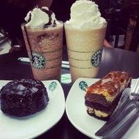 Photo taken at Starbucks by Sophie N. on 12/15/2012