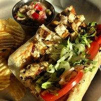 Foto scattata a Green Tomato Cafe da Jennifer M. il 11/12/2012