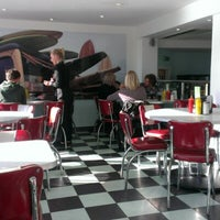 Photo taken at Woodies Longboard Diner by Dean S. on 11/9/2012
