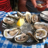 Photo taken at Tom's Oyster Bar by Doug B. on 7/4/2013