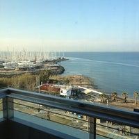 Photo taken at Poseidon Hotel by Elena O. on 2/18/2013
