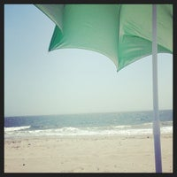 Photo taken at Sea Gate Beach by Erin S. on 7/2/2014