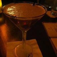 Photo taken at Fleming's Prime Steakhouse & Wine Bar by Kinshasa H. on 12/3/2012
