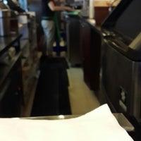 Photo taken at Starbucks by roy n. on 5/17/2014