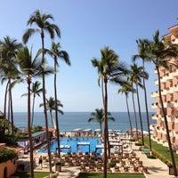 Photo taken at Crown Paradise Golden Resort & Spa by Juan Carlos E. on 11/10/2012
