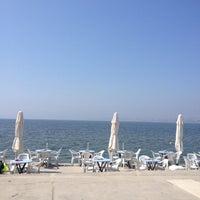 Photo taken at Rıhtım Beach by Ümit S. on 4/13/2016