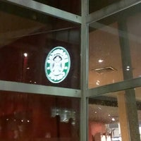 Photo taken at Starbucks by Eveline Q. on 12/1/2012