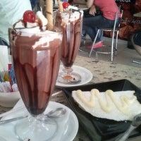 Photo taken at Delícia Café by Aninha's O. on 5/11/2013