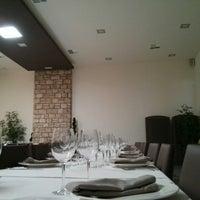 Photo taken at Atenea Restaurante by Oscar on 8/24/2013
