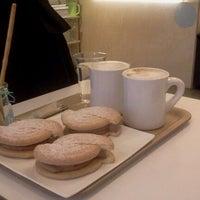 Photo taken at cafe  h 2 by Caroline on 10/17/2011