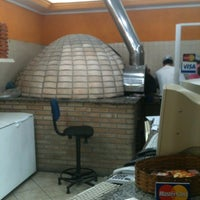 Photo taken at Bocatto Pizzaria by Rogerio C. on 10/20/2012