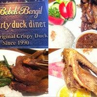 Photo taken at Bebek Bengil (Dirty Duck Diner) by iPrada i. on 9/30/2012
