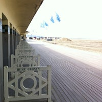 Photo taken at Plage de Deauville by Frederic D. on 10/2/2012