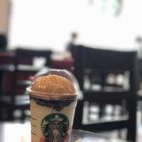 Photo taken at Starbucks by shin g. on 4/12/2017
