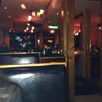 Photo taken at Amsterdam Cafe by Charles D. on 1/12/2014