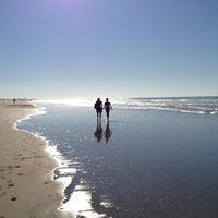 Photo taken at La Victoria Beach by Óscar L. on 12/29/2012