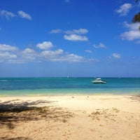 Photo taken at Mont Choisy Beach by Cedric A. on 10/16/2012