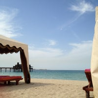 Photo taken at Madinat Jumeirah Private Beach by Liza P. on 10/24/2012
