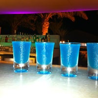 Photo taken at Nasimi Beach by Andreas K. on 5/16/2013