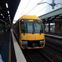 Photo taken at Strathfield Station (Platforms 1 & 2) by Tim P. on 7/8/2016