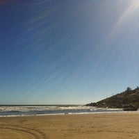 Photo taken at Praia Norte de Itapirubá by Raquel F. on 12/24/2012
