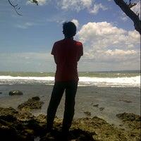 Photo taken at Rancabuaya Beach by Tio S. on 2/28/2013