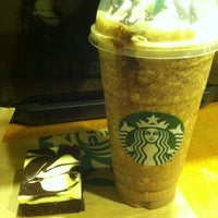 Photo taken at Starbucks by Roxy C. on 3/16/2013