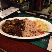 Photo taken at Jamaica Gates Caribbean Restaurant by Taylor R. on 2/6/2014
