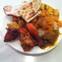 Photo taken at Shalimar Indian Restaurant by Roderick C. on 2/8/2014