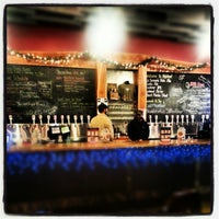 Photo taken at Highland Brewing Company by Caitlin S. on 12/21/2012