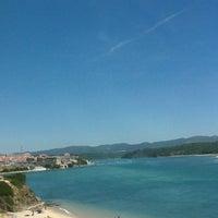 Photo taken at Praia de Vila Nova de Milfontes by Catarina V. on 6/22/2013