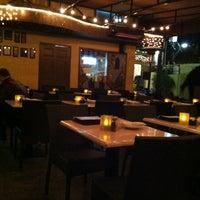 Photo taken at Bossa Nova Brazilian Cuisine by Mike T. on 12/21/2012