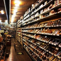Photo taken at Jenuwine Cigar Lounge by George M. on 3/23/2014