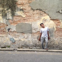 Photo taken at Penang Street Art : Little Boy with Pet Dinosaur by Mohamad Arif N. on 8/14/2013