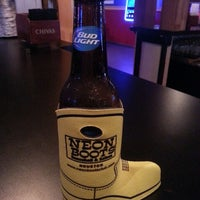 Photo taken at Neon Boots Dancehall & Saloon by Michael C. on 8/16/2013