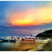 Photo taken at Teluk Bahang Beach by Dave R. on 11/28/2012