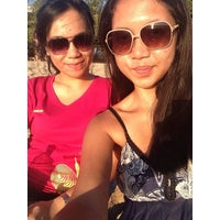 Photo taken at Kuta Beach by Mira A. on 10/18/2013
