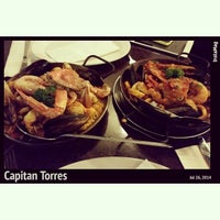 Photo taken at Capitan Torres Spanish Restaurant by Jenny O. on 7/26/2014