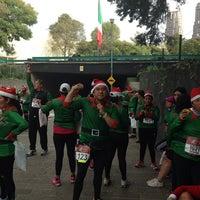 Photo taken at Christmas Run by Cesar U. on 12/15/2013