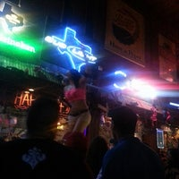 Photo taken at Coyote Ugly Saloon - San Antonio by Stephanie S. on 7/20/2013