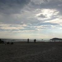 Photo taken at Praia de Juquehy by Andrea V. on 2/16/2013