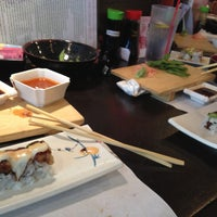 Photo taken at Sushi Zen by Carlos S. on 5/3/2013