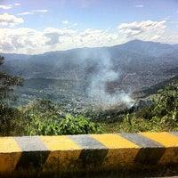 Photo taken at Mirador vía Santa Elena by Juan Esteban D. on 9/20/2013
