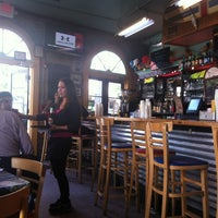 Photo taken at 701 Bar & Restaurant by Claudia C. on 3/28/2013