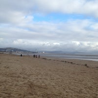Photo taken at Swansea Bay Beach by Timothy F. on 12/25/2012
