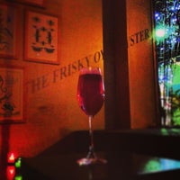 Photo taken at The Frisky Oyster by Robby B. on 12/21/2012