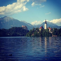 Photo taken at Blejsko Jezero / Lake Bled by Sara O. on 7/25/2013