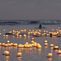 Photo taken at Memorial Day Lantern Floating Ceremony @ Ala Moana Beach Park by Eric S. on 5/27/2014