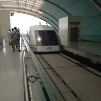 Photo taken at Maglev Train Longyang Road Station by Di F. on 6/20/2013