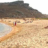 Photo taken at Panormos Beach by Hakan on 7/16/2013